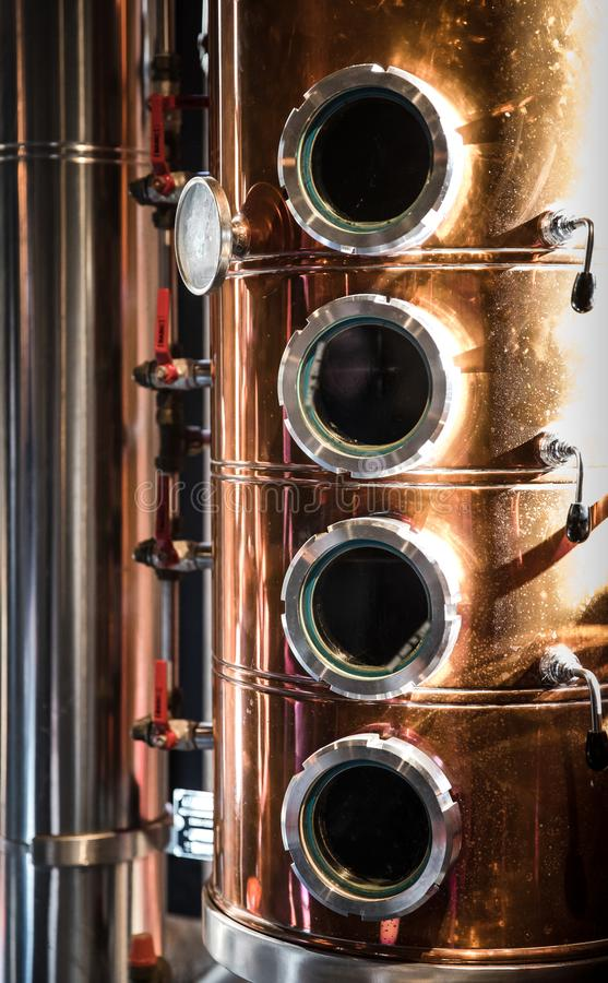 Close up Distiller boiler: The process of making the gin begins here in this kettle.  royalty free stock photos