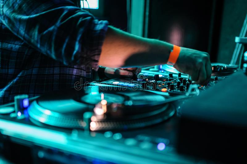 Close up of dj control panel playing party music on modern player in disco club royalty free stock photo