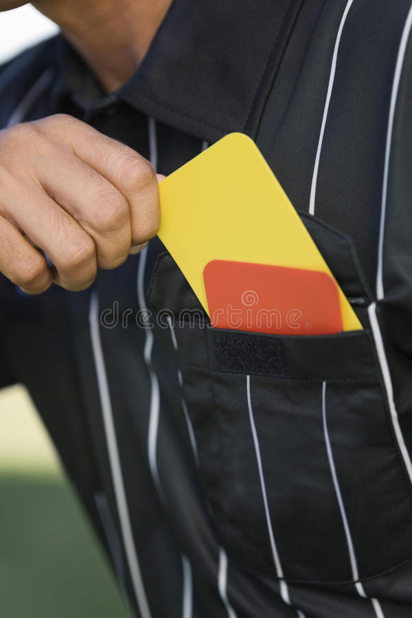 Close up do bolso de Taking Card From do árbitro imagens de stock royalty free