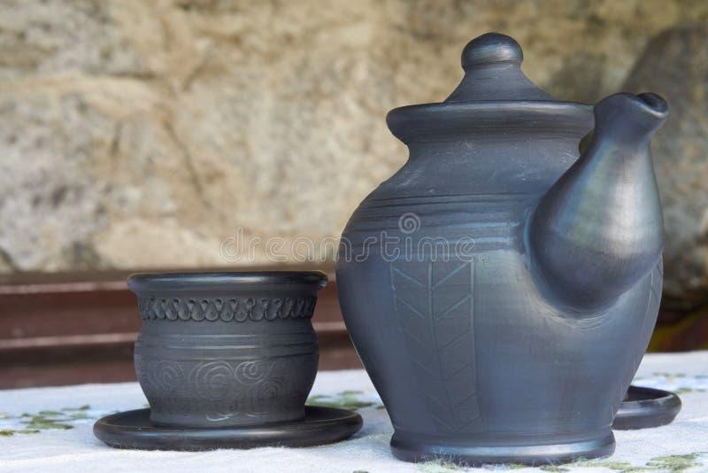 Close up do bule e da xícara de chá fotografia de stock royalty free