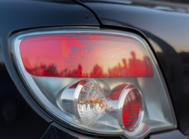 Close-up do carro da luz traseira foto de stock