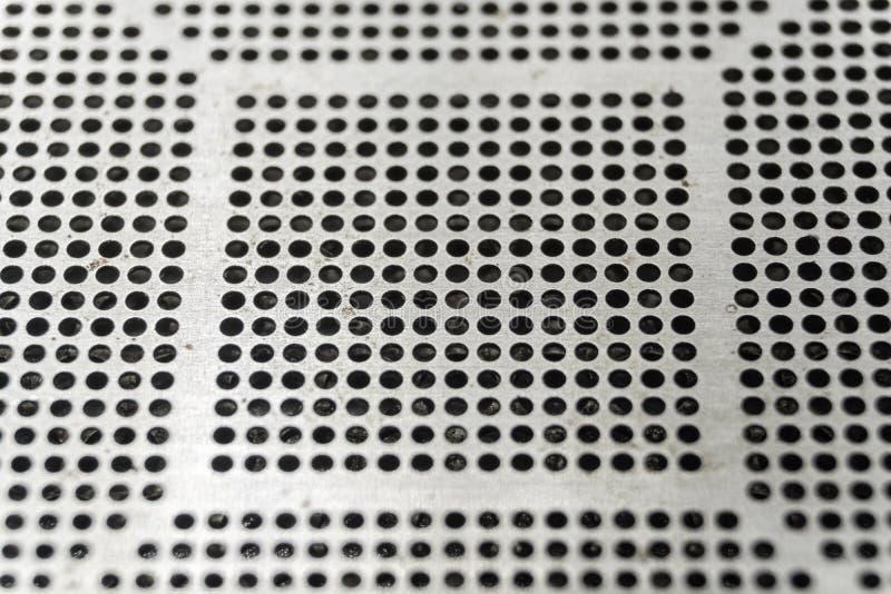 Close-up do estêncil pequeno usado do corte do passo da elevada precisão do CNC do laser para a microplaqueta de BGA que reballin imagem de stock
