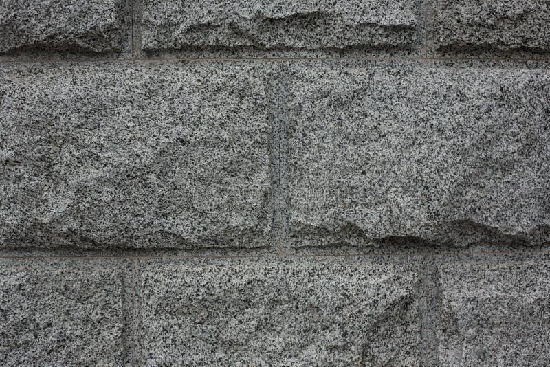 Close up do fundo cinzento da textura do granito Parede de pedra do granito fotos de stock