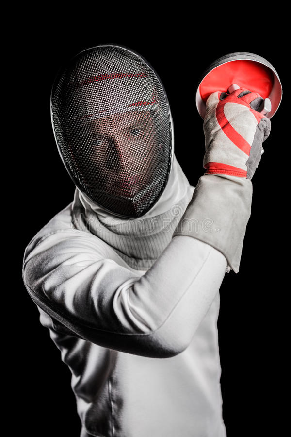 Close-up do homem que veste que cerca o terno que pratica com espada fotografia de stock