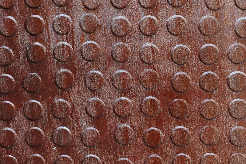 Close up do metal oxidado com botões fotos de stock