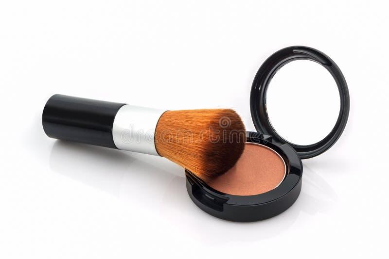 Close up do pó de cara e da escova da composição fotos de stock