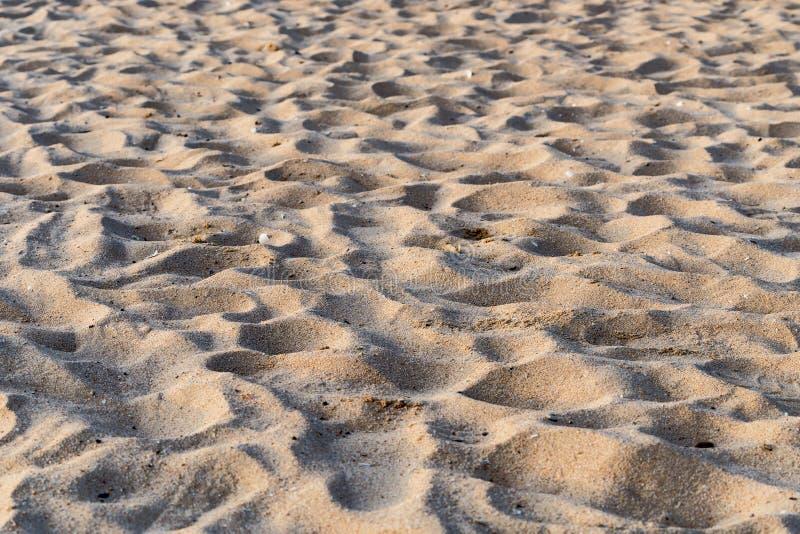 Close up do teste padrão da praia da areia para o fundo abstrato fotografia de stock royalty free