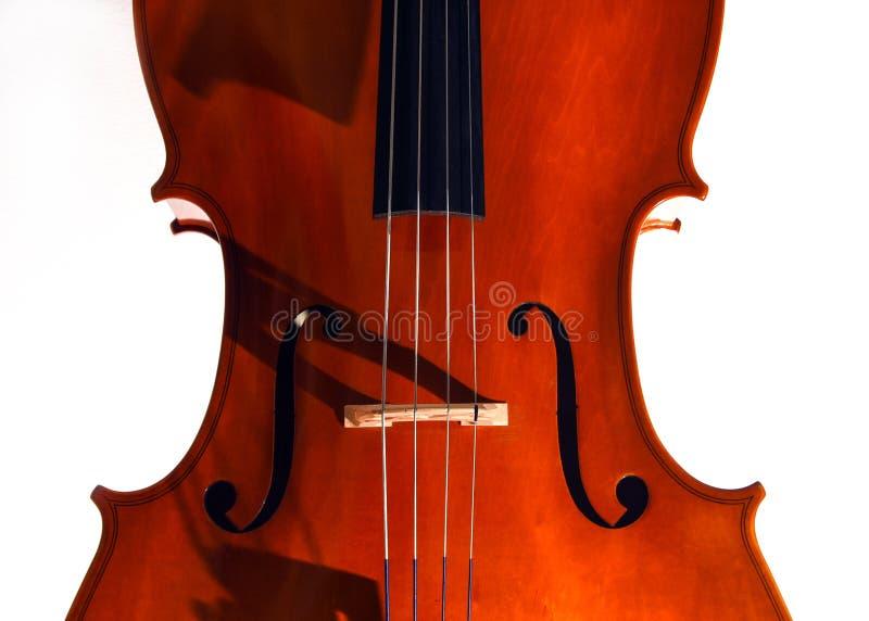 Close up do violoncelo na luz dram?tica fotos de stock royalty free