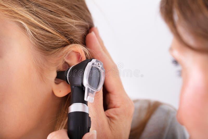 Doctor Checking Girl`s Ear royalty free stock photos