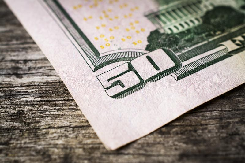 Close-up of 50 Dollar bill. Close up of 50 Dollar bill on wooden table royalty free stock photos