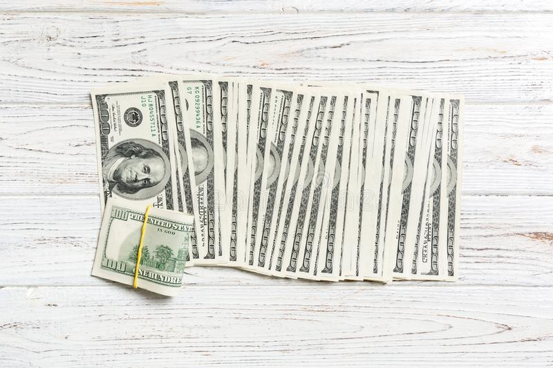 Close up of 100 dollar bills in a row on wooden background. Top view of salary concept royalty free stock photos