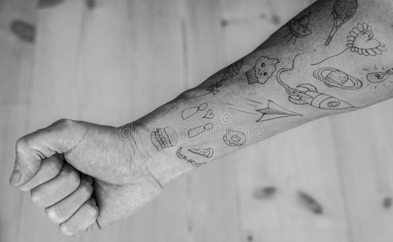 Close up of doodle tattoos on forearm.  royalty free stock photography