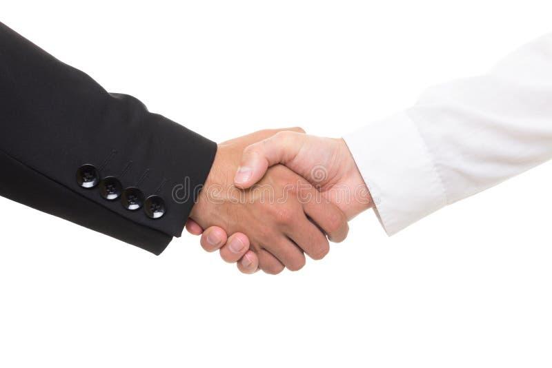 Close up dos homens de negócios que agitam as mãos fotografia de stock royalty free