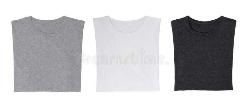 Close-up dos três t-shirt (preto, branco e cinzento) foto de stock royalty free
