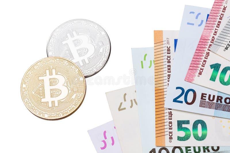 Close-up dourado e de prata Bitcoins de Bitcoins e euro no branco imagem de stock royalty free