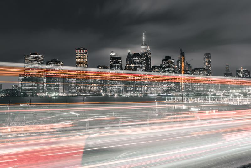 Long exposure of traffic with downtown Manhattan in view royalty free stock images