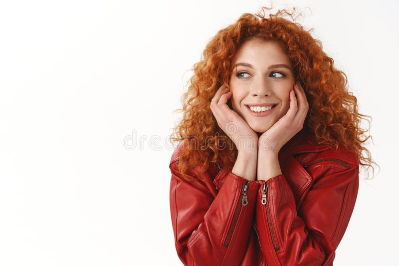 Close-up dreamy flirty good-looking fabulous ginger girl curly hairstyle silly daydreaming look left lean hands dreaming stock image