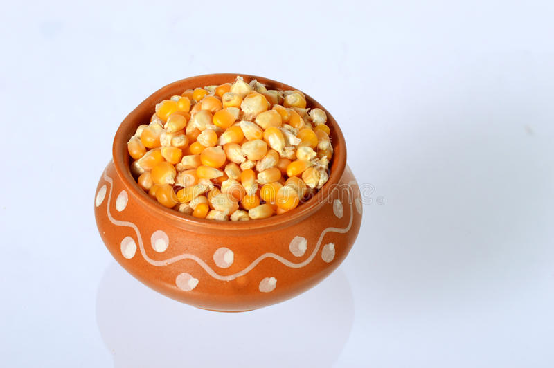 Close Up of Dried corn in clay pot royalty free stock photos