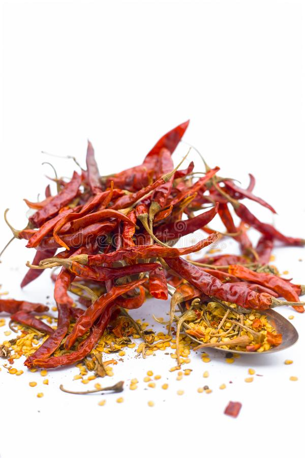 Close up of dried red chili with its flakes or Crushed red pepper isolated on white. stock photo
