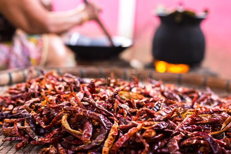 Close up of dried red chilies in wood pan stock image