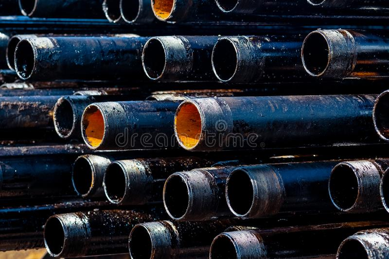 Close up drill pipe thread with pipe dope grease lay down on rig floor at oil and gas on shore location. Close up drill pipe thread with pipe dope grease lay royalty free stock image