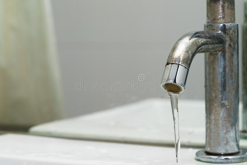 Close up of driping water drop or water leaking - save water con. Cept royalty free stock photos