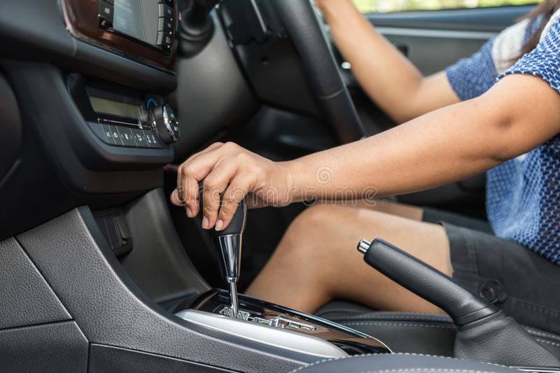 Close up driver left hand shifting the gear stick royalty free stock photography
