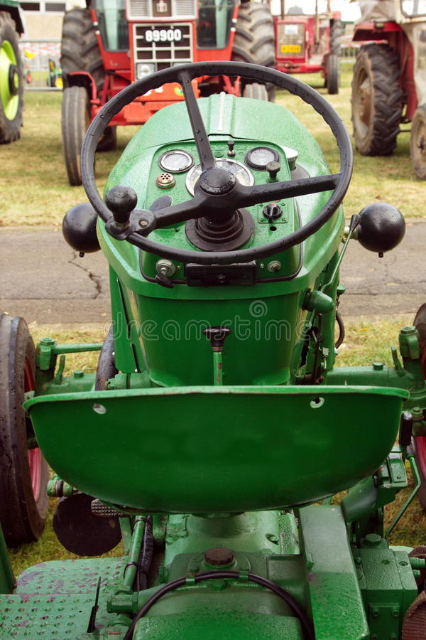 Close-up of driving place of green tractor stock photography