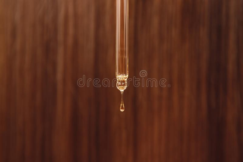 Close-up drop oil restore and recovery hair is applied to head bulbs. Concept hairdresser spa salon royalty free stock photography