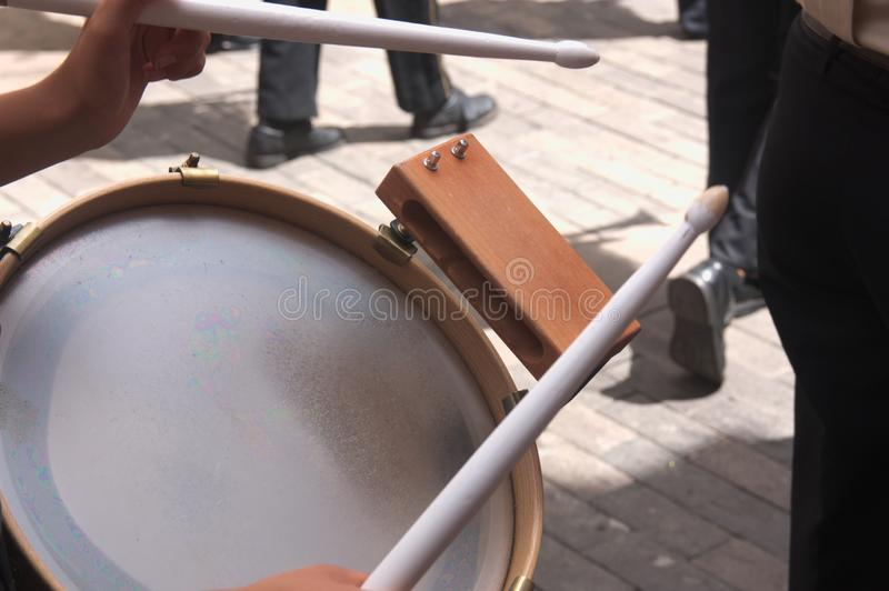 Close-up of a drum with drumsticks during a street party stock photos