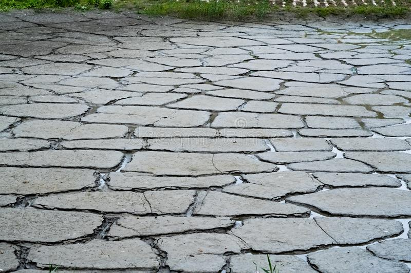 Dry river bed. Close up of dry river bed with cracked ground royalty free stock photos
