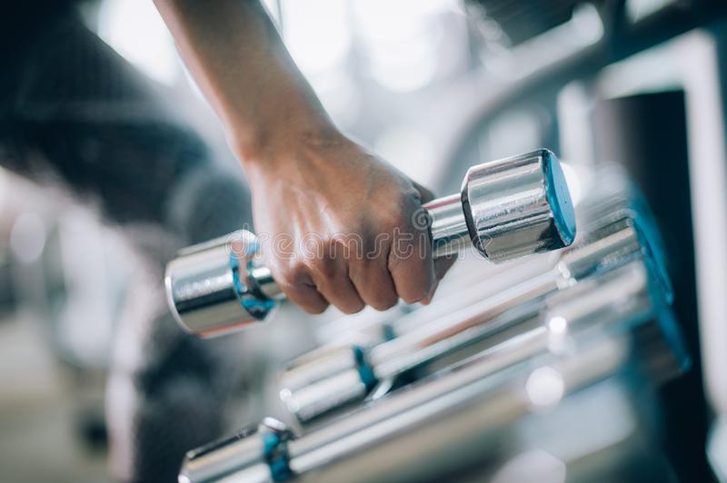 Close up of dumbbells in woman hand. Power fitness, sport, training, lifestyle royalty free stock photos