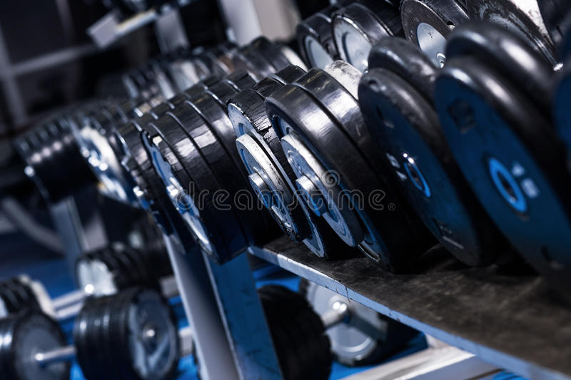 Close up of dumbells. In gym royalty free stock photos