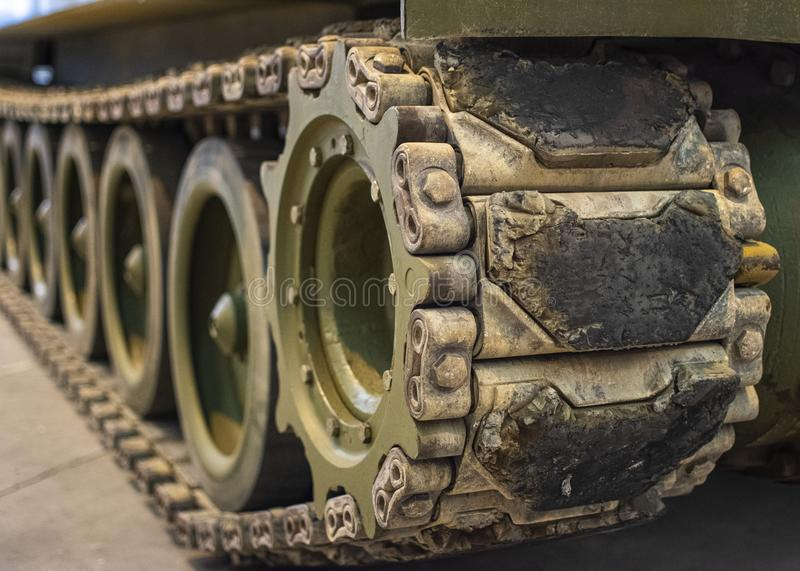 Close-up of dusty caterpillar wheels of military tank royalty free stock photo