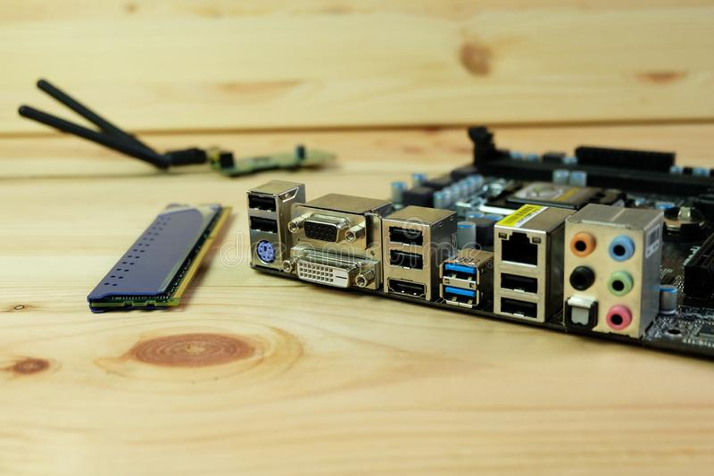 Close up dvi,vga,USB 3.0, HDMI and various connection ports of Computer motherboards On wooden royalty free stock images