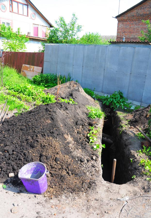 Earthen trench dug to lay water pipes. stock photos