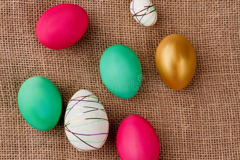 Close up Easter festive eggs on burlap. royalty free stock photo