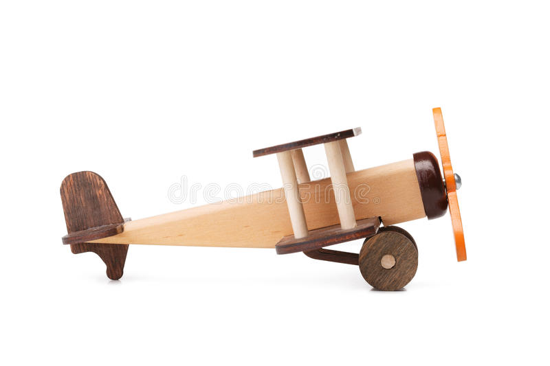 Close-up of an eco-friendly product for children`s games, isolated on a white background. A developing toy airplane. A close-up picture of a brown wooden toy stock image