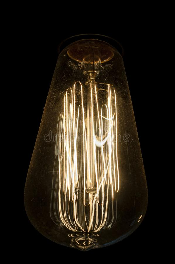 Close-up of an Edison incandescent light bulb. With a black background stock photo