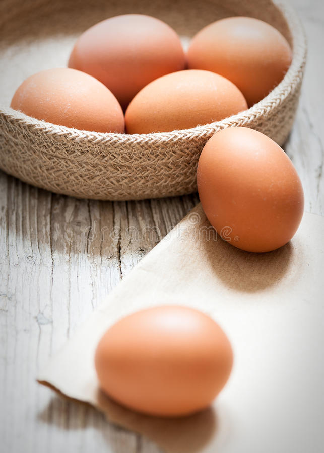close-up of eggs on aged wood royalty free stock photos