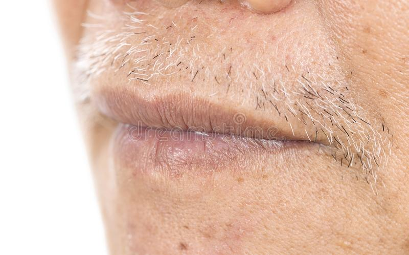 Close-up of elderly asian man mouth with wrinkle on face stock images