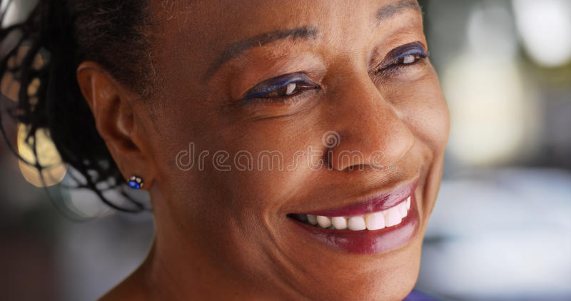 A close-up of an elderly black woman looking into the distance stock photos