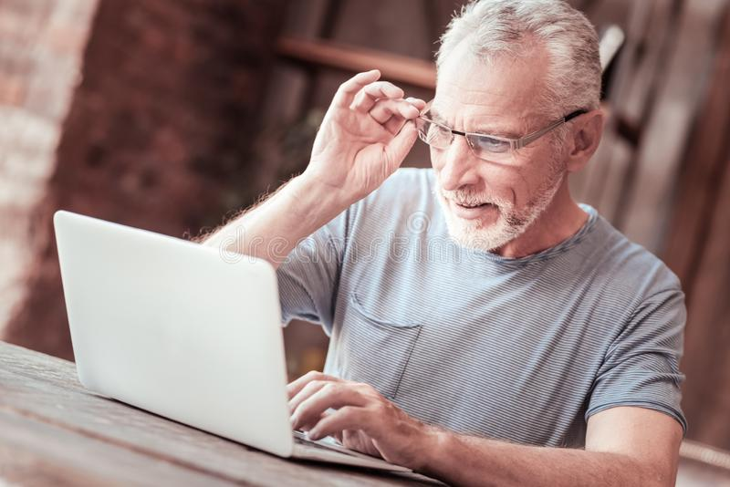 Close up of elderly man with a laptop royalty free stock images