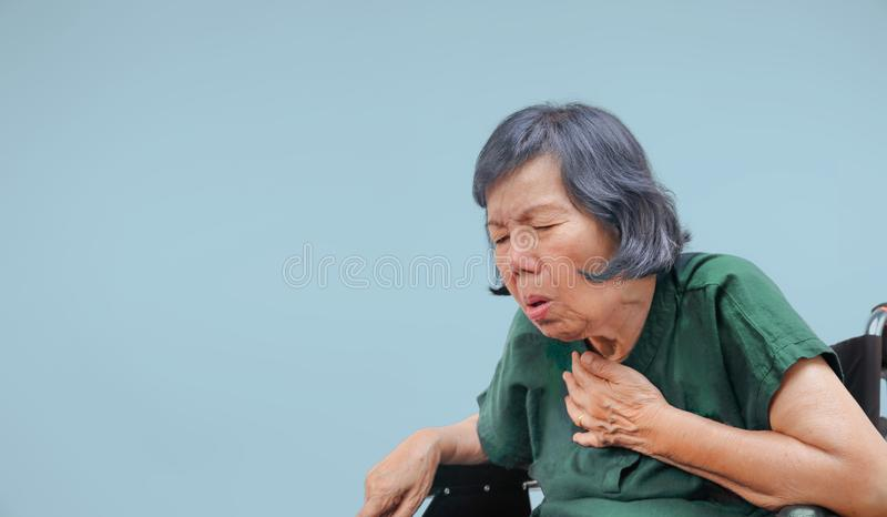 Elderly woman cough ,choke on wheelchair. Close up elderly woman cough ,choke on wheelchair royalty free stock images