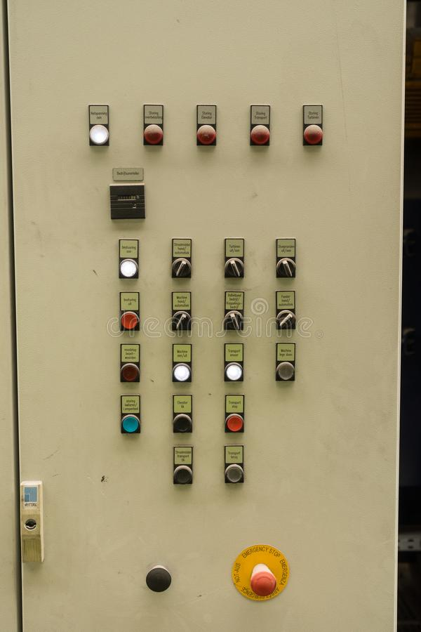 Close up of electric control panel with switches, multi colored indicators and emergency stop. Close up of electric control panel with switches, multi colored stock image