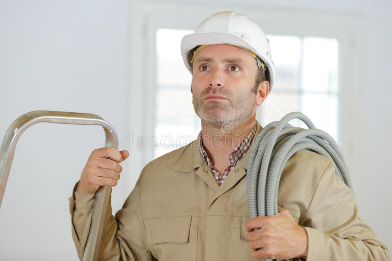 Close up electrician technician at work stock photography