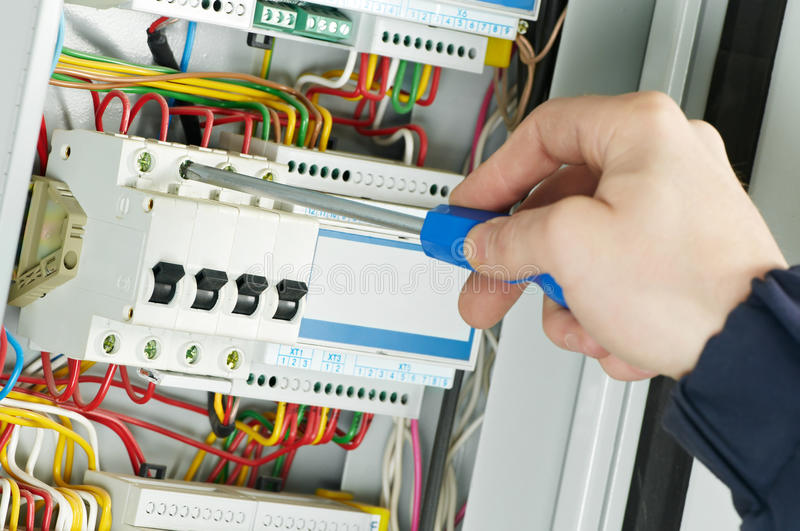 Close-up of Electrician work stock photos
