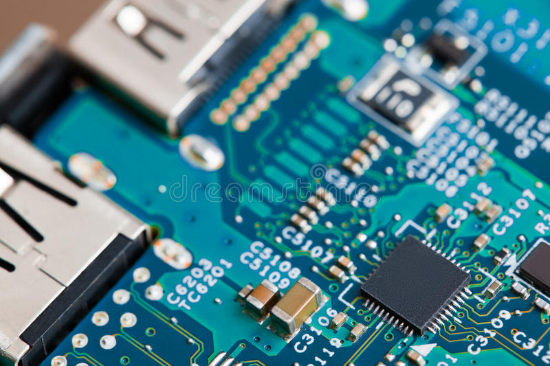 Close up of electronic components on the motherboard, microprocessor chip. Close up of electronic components on the motherboard microprocessor chip royalty free stock photo