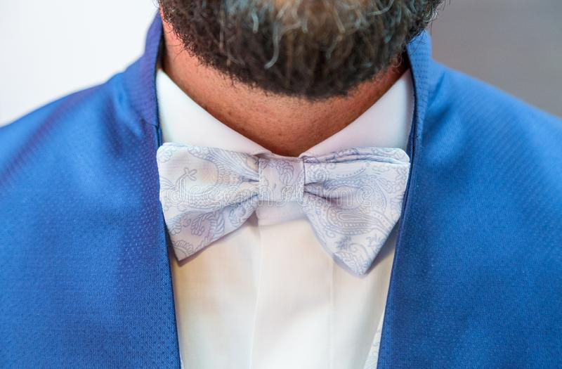 Close up of elegant bow-tie of the groom stock image