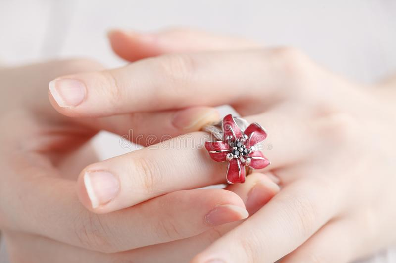 Close up of an elegant ring on the young woman`s finger royalty free stock photos
